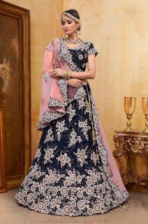 Bridal Wear Lehengas, Net & Velvet Fabrics- N.Blue & light Peach colour